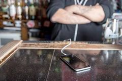 Annoying Things People Do To Piss Off Bartenders - Asking To Charge Your Phone Behind The Bar